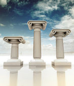 Three ancient Greek Ionian column as winner podium — Stock Photo