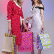 Closeup of two attractive happy girls out shopping — Stok fotoğraf