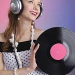 Girl with vinyl disc closeup — Stock Photo