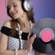 Girl with vinyl disc closeup — Stock Photo