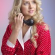 Portrait of beautiful blond woman with retro phone — Stock Photo