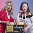 Stock Photo: Closeup of two attractive happy girls with retro radio