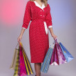 Beautiful girl with shopping bags — Stock Photo #11826775