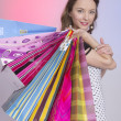 Beautiful girl with shopping bag — Stock Photo #11826808