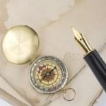 Retro compass and pen — Stock Photo