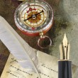 Gold pen with letter, compass and writing — Stock Photo