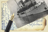 Old postcards with pen — Stock Photo