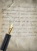 Gold Pen with Letter and Writing — Stock Photo