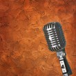 Royalty-Free Stock Photo: Texture wall background with microphone