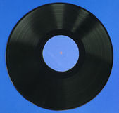 Vinyl record on blue — Stock Photo