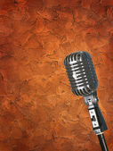 Texture wall background with microphone — Stock Photo