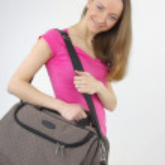 Beautiful girl with modern bag — Stock Photo #11985405