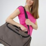 Beautiful girl with modern bag — Stock Photo #11985434