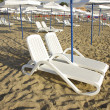 Beach chairs and umbrellas — Stock Photo #11989636