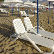 Beach chairs and umbrellas — Stock Photo #11989662