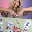 Smiling blond woman with retro bag — Stock Photo