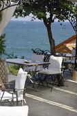 Nice cafe upon the sea — Stock Photo