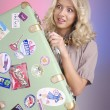 Smiling blond woman with retro bag - Stock Photo