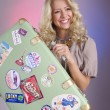Smiling blond woman with retro bag — Stock Photo #11995491