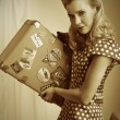 Pretty retro woman with suitcase — Stock Photo