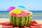 Watermelon on the beach background — Stock Photo