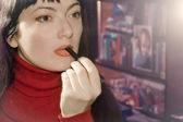 A woman dyes lips — Stock Photo