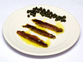 Salted sardines with capers — Stock Photo