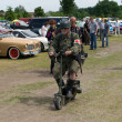 ������, ������: PAAREN IM GLIEN GERMANY MAY 26: A military medic on Motorized scooter The oldtimer show in MAFZ May 26 2012 in Paaren im Glien Germany