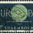 Royalty-Free Stock Photo: LUXEMBOURG - CIRCA 1960: A stamp printed in Luxembourg, shows the word EUROPE, the letter O as a bicycle wheel with 19 spokes, circa 1960