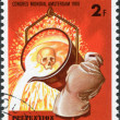 Stock Photo: LUXEMBOURG - CIRC1980: stamp printed in Luxembourg, is dedicated to 9th World Congress on Prevention of Occupational Accidents & Diseases, Amsterdam, shows Worker Pouring Molten Iron, circa