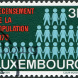 Royalty-Free Stock Photo: LUXEMBOURG - CIRCA 1970: A stamp printed in Luxembourg, is devoted to census shows number of pieces - a symbol of the census, circa 1970
