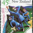 Stock Photo: NEW ZEALAND - CIRCA 1991: A stamp printed in New Zealand, is dedicated to Christmas, depicts the shepherds in the field looking at the star of Bethlehem, circa 1991