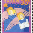 NEW ZEALAND - CIRCA 1987: A stamp printed in New Zealand, is dedicated to Christmas, is shown singing carols: Hark! The Herald Angels Sing, circa 1987 — Stock Photo