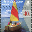 NEW ZEALAND - CIRCA 1999: Postage stamps printed in New Zealand, shows yacht Optimist, circa 1999 — Stock Photo