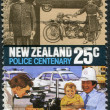 Stock Photo: NEW ZEALAND - CIRC1986: Postage stamps printed in New Zealand, is dedicated to centennial of Police Force Act, shows 1920 motorcycle, 1940s car, modern patrol cars and graphologist, circ1986