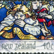 Stock Photo: NEW ZEALAND - CIRC1996: stamp printed in New Zealand, dedicated to Christmas shows Heavenly host praising God, circ1996