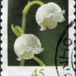 GERMANY - CIRCA 2010: A stamp printed in Germany, shows the flower Lily of the Valley (Convallaria majalis), circa 2010 — Stock Photo