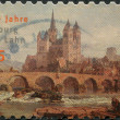 GERMANY - CIRCA 2010: A stamp printed in Germany, is dedicated to the 1100th anniversary of Limburg an der Lahn, shows the Catholic Cathedral of Limburg, circa 2010 - Stock Photo
