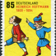 Royalty-Free Stock Photo: GERMANY - CIRCA 2009: A stamp printed in Germany, is dedicated to the 200th anniversary of Heinrich Hoffmann, depicts a scene from a children's book Struwwelpeter, circa 2009