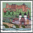 GERMANY - CIRCA 1996: A stamp printed in Germany, is dedicated to the 800th anniversary of Heidelberg, shows the old bridge to the city gates, the castle and the Church of the Holy Spirit, circa 1996 — Stock Photo