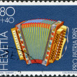 SWITZERLAND - CIRCA 1985: A stamp printed in Switzerland, shows a folk instrument Diatonic accordion, 20th century, circa 1985 — Stock Photo
