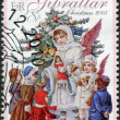 GIBRALTAR - CIRCA 2005: A stamp printed in Gibraltar, is devoted to Christmas, shows an angel, a Christmas tree and children, circa 2005 — Stock Photo
