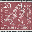 Royalty-Free Stock Photo: GERMANY - CIRCA 1960: A stamp printed in Germany, dedicated to 37th Eucharistic World Congress, Munich, depicted Dove, Chalice and Crucifix, circa 1960