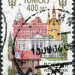RUSSIA - CIRCA 2004: A stamp printed in Russia, dedicated to the 400th anniversary of Tomsk, shows the city administration, Church of the Resurrection, Tomsk State University, a monument of wooden arc — Stock Photo #11974754
