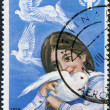 GREECE - CIRCA 1979: A stamp printed in Greece, is dedicated to the International Year of the Child, depicts a girl and pigeons and emblem, circa 1979 - Stock Photo