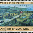 Royalty-Free Stock Photo: GREECE - CIRCA 1991: A stamp printed in Greece, is dedicated to the 50th anniversary of the invasion of the German armed forces in Crete, shows the Battle of Crete by Ioannis Anousakis, circa 1991