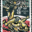 GREECE - CIRCA 1989: A stamp printed in Greece, dedicated to the Olympic Games in Athens-96, is shown Wrestlers and view of Delphi, circa 1989 — Stock Photo