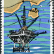 Stock Photo: GREECE - CIRC1981: stamp printed in Greece, dedicated to Inauguration of oil production at Thassos Island, shows Oil Rig and Map of Thassos Island, circ1981