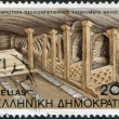Royalty-Free Stock Photo: GREECE - CIRCA 1985: A stamp printed in Greece, shows the catacombs of the island of Milos, Altar and Central Gallery, circa 1985