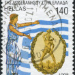 Stock Photo: GREECE - CIRC1998: Postage stamps printed in Greece, dedicated to 50th anniversary of Incorporation of Dodecanese Islands into Greece, shows Greece and Colossus of Rhodes, Greek flag, circa